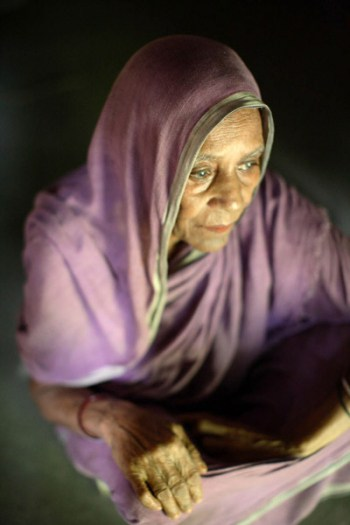 Hamida is around 70 years old and nearly blind. She is a widow and lives alone in a small shed. Kate Holt.