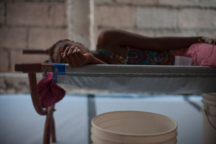 A woman suffering from cholera is photographed in a Cholera Treatment Centre. Kate Holt.
