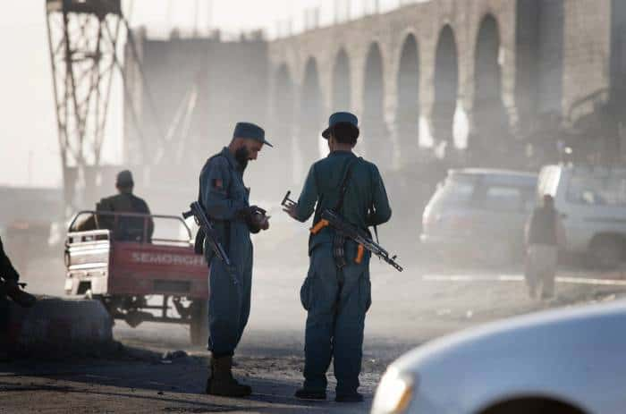 Afghan National Police man a checkpoint in Kandahar. Kate Holt.