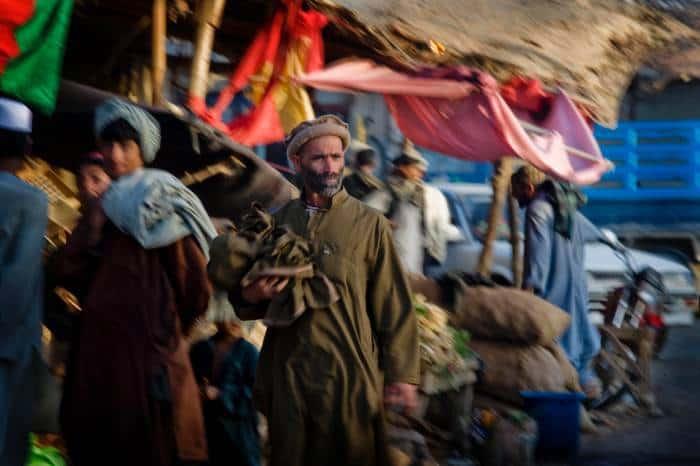 An elderly man walks through the market in Garmsir, Helmand Afghanistan on the 26th March, 2010. Kate Holt.