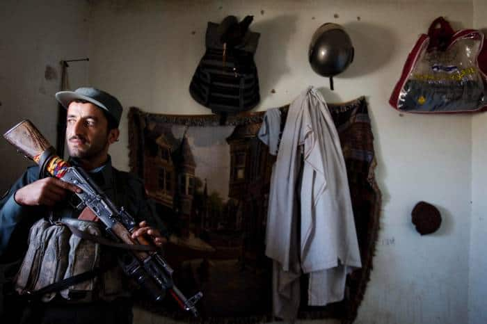 A newly trained Afghan police officer from the Afghan National Police Force (ANP) poses for a photograph. Kate Holt.