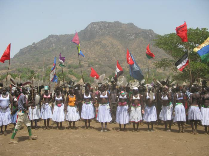 Women in Lirya, Southern Sudan, wait to receive the official visit. Kate Holt.