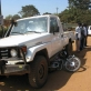 A car runs over a motorcycle at the Mobil Junction in Juba, Southern Sudan. Kate Holt.