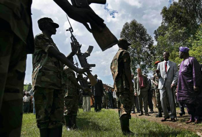 Rebel leader of the CNDP, General Laurent Nakunda and ex Nigerian President Onasambo. Kate Holt.