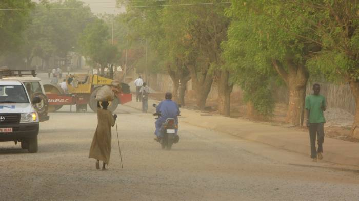 A woman walks down a newly constructed road in Juba, Southern Sudan. Kate Holt.