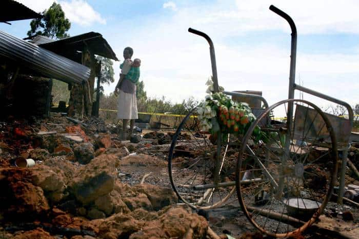 A woman stands in the remains of a church near Eldoret that was burnt. Kate Holt.