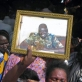 A family member holds up a photograph of Officer Abut who was killed in Yambio while on duty. Kate Holt.