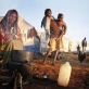 A woman and her children make tea in the early morning in a camp for displaced people. Kate Holt.