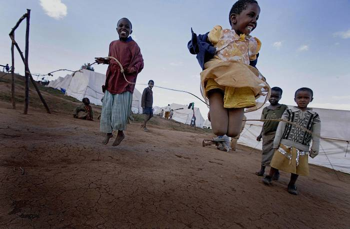 A group of children play in a camp for people displaced by land disputes in Molo, Kenya. Kate Holt.