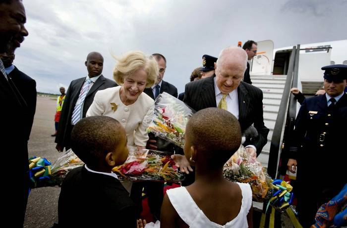 Quentin Bryce, the Governor General of Australia, and her husband, Michael Bryce receive flowers upon their arrival. Kate Holt.
