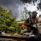 A Kenyan Soldier holds an RPG on top of his vehicle after firing a rocket into the Westgate Centre. Kate Holt.