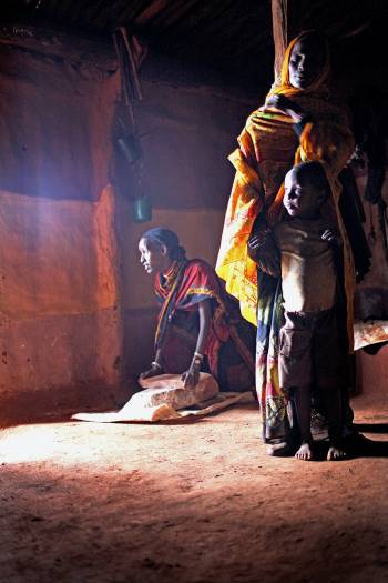 Galamo Dima, with her son and daughter in their families hut. Kate Holt.