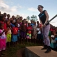 Katy Perry pumps water at a water point on a visit to a primary school that has been rebuilt by UNICEF. Kate Holt.
