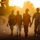 A group of boys walk home in the sunnset in Goz Baeda, Eastern Chad. Kate Holt.