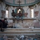 Gang members hang out on the disused alter of St Annes Catholic Church. Kate Holt.