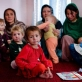Women and their children listen to Norsia Najafi, who has been a Community Based Educator (CBE) since 2005. Kate Holt.
