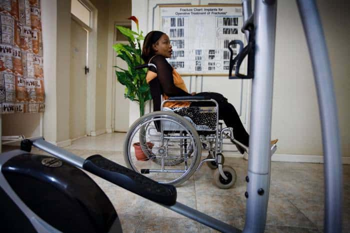 Winne Magare, 39 years old, who became tetraplegic after being injured in a traffic accident, poses for photographs. Kate Holt.