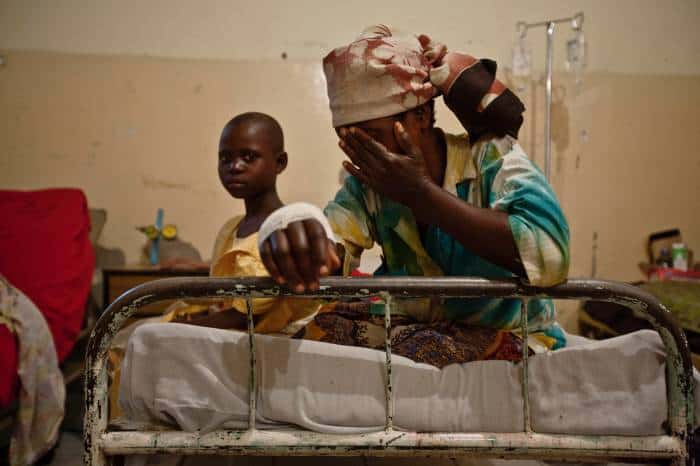 A woman injured in recent fighting between rebel M23 soldiers and Congolese Government soldiers. Kate Holt.