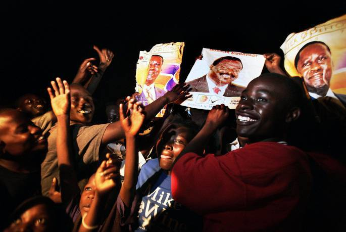 People celebrate in the streets of Kisumu, the heartland of Raila Odinga the leader of Kenys'a ODM Party support. Kate Holt.