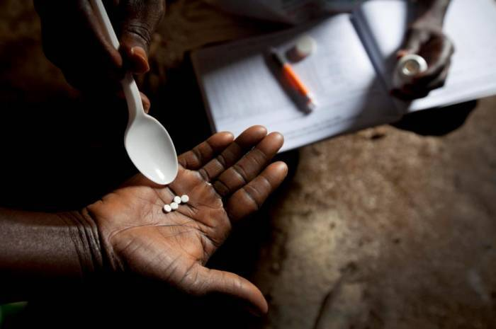Community Director Distributor (CDD's) distribute Mectizan, the drug used to prevent river blindness. Kate Holt.