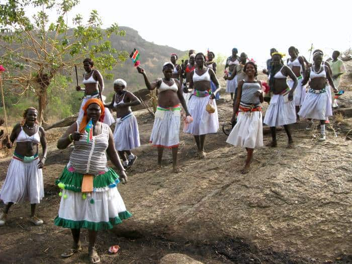 Lokoya women celebrate their return to their village after 20 years of civil war. Kate Holt.