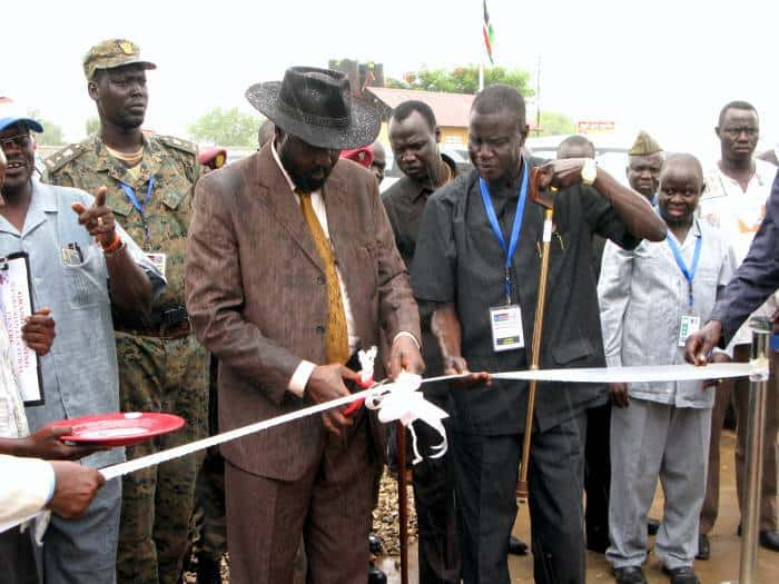 His Excellency Salva Kiir Mayardit cuts the ribbon to open the newly renovated Cultural Centre. Kate Holt.