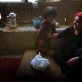 Sakina, plays with one of her six children at their home in District 7 of Kabul. Kate Holt.