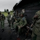 Congolese Government Soldiers (FARDC) wait at an army post. Kate Holt.