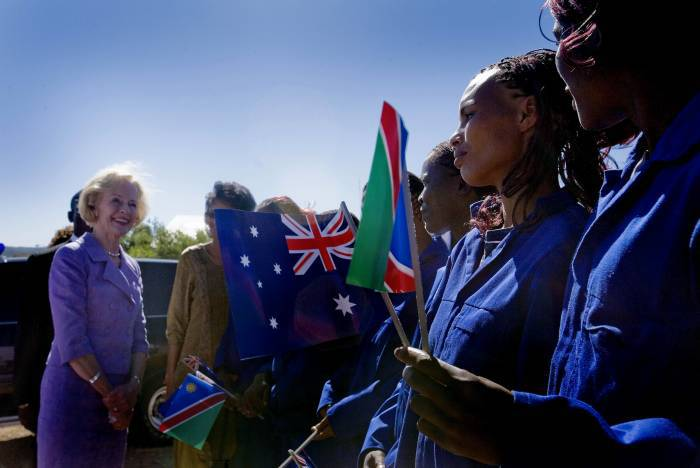 Quentin Bryce AC, Governor General of Australia, talks to women who were prostitutes, but now mend bicycles. Kate Holt.