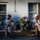 Patients wait outside the OPD unit of Bost Hospital, in Lashkar Gah, Helmand, Afghanistan. Kate Holt.