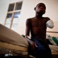 Elie Kakule,who is only 11 years old had his arm amputated after he was hit by a bomb during recent fighting. Kate Holt.