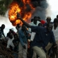 People run for safety as barrels of petrol explode in a market square in Juba. Kate Holt.