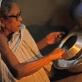 """Shunda Bala washes up in the family's kitchen """"I find it hard to do housework now"""". Kate Holt."""