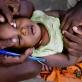 Trachoma monitor, Jeremiah Ntors Sankaire examines the eyes of one year old Ezekhiel Lemayian. Kate Holt.