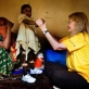 Clako Ali, four years old, who contracted polio last year, is helped to stand up in her braces. Kate Holt.
