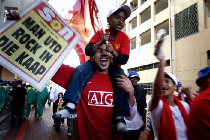 Manchester United supporters arrive at the opening game of the Vodacom Challenge series in Cape Town. Kate Holt.