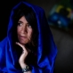A woman whose family was displaced by fighting in Helmand province poses for a photograph. Kate Holt.