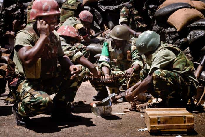 Burundian soldiers provide fire support from a rooftop position at the old Military Academy, in Mogadishu, Somalia. Kate Holt.