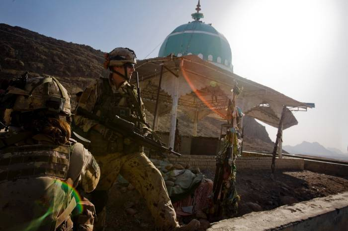 A newly trained Afghan policeman stands on the roof of the police station at the new administrative compound. Kate Holt.