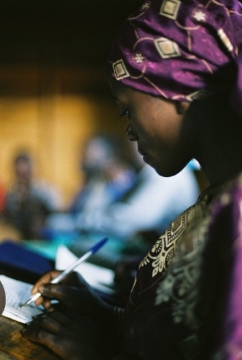 A woman in an adult education workshop being run by ActionAid in Goma. Kate Holt.