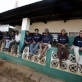 Earthwatch volunteers stand outside the main Research office in Gazi Bay. Kate Holt.