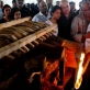 Ramesh Vaya lights the funeral pyre of his wife, Malti. Kate Holt.