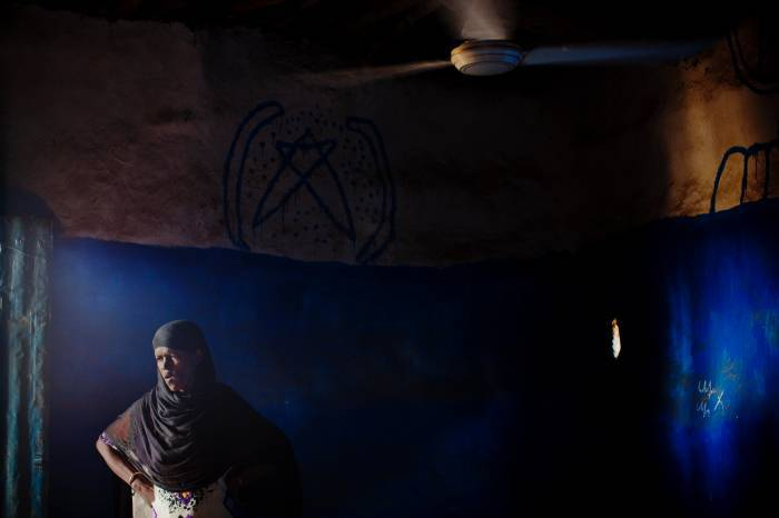 A teacher poses for a photograph in a student hostel that APDA runs in the town of Asayita. Kate Holt.