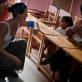 Katy Perry talks to a young girl on a visit to the Ilaiko Child Protection Centre. Kate Holt.