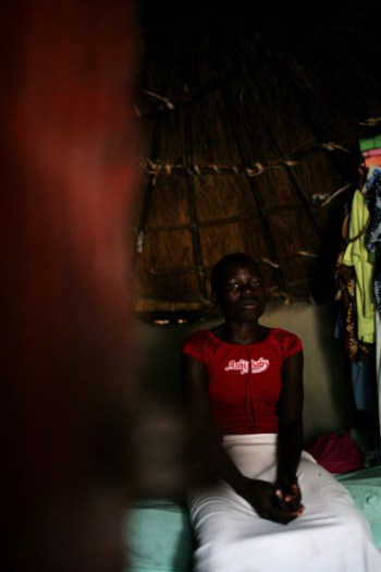 A young girl who lives on the streets of Juba is photographed here in a shelter she sometimes uses. Kate Holt.