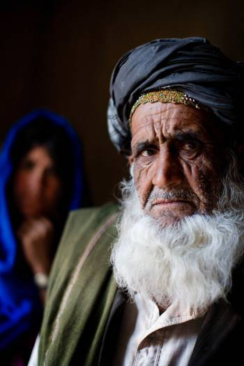 Abdul Hakin, whose family fled from Zabul, poses for a photograph in their temporary home. Kate Holt.