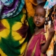 Newly arrived refugees from Somalia wait to be registered at IFO camp. Kate Holt.