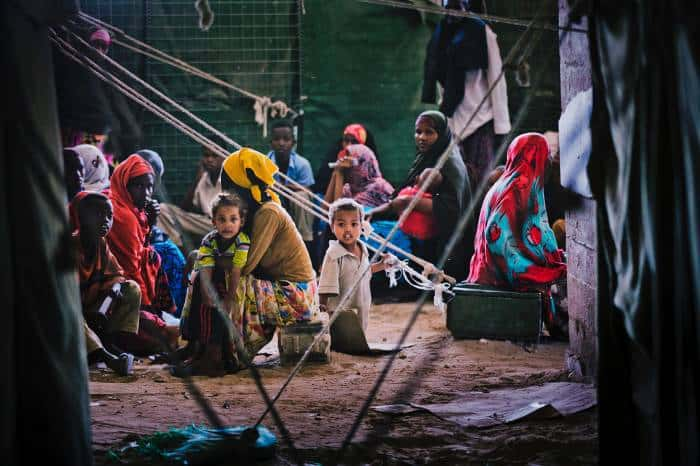 Women wait with their children to see a doctor in the AMISOM Out Patients Department. Kate Holt.