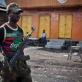 M23 rebel soldiers patrol in the town of Sake that they seized from Congolese Government soldiers. Kate Holt.