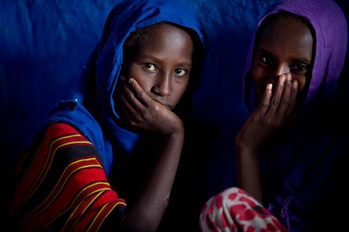 Young Afar girls pose for photographs and do their homework in a hostel that APDA runs. Kate Holt.